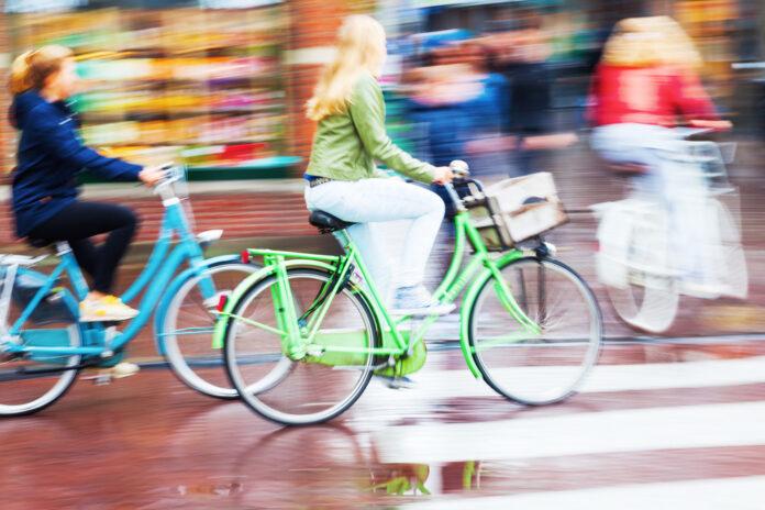 photo-of-girls-riding-bikes-in-rain-netherlands
