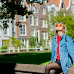 girl sitting at street in Amsterdam
