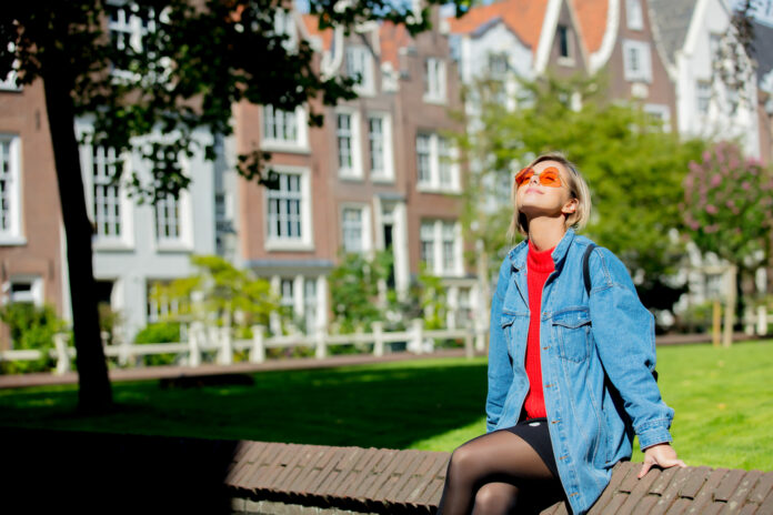 photo-of-girl-sitting-in-sun-after-moving-to-amsterdam