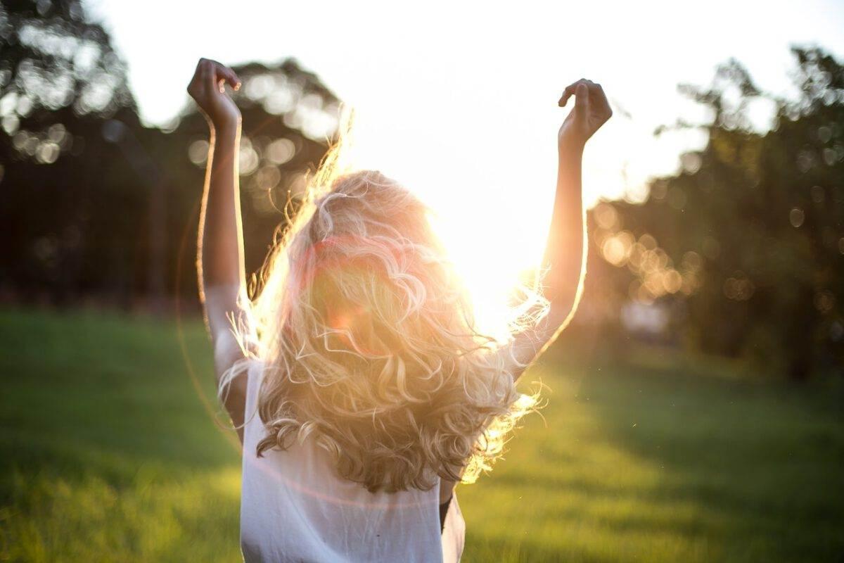 photo-of-girl-dancing-in-sunshine-in-field