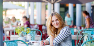 photo-of-woman-writing-budget-in-amsterdam-at-cafe