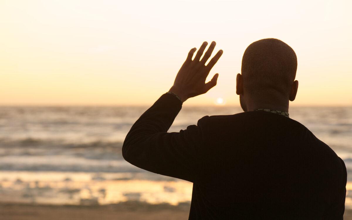 photo-of-man-waving-at-sunset
