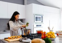 photo-of-a-woman-cooking-with-groceries-delivered-to-her-home-by-a-dutch-grocery-delivery-service