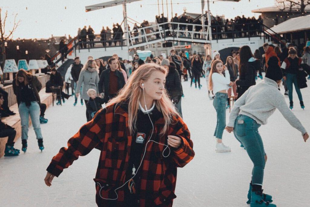 photo-of-girl-ice-skating-at-dam-square-amsterdam-rink