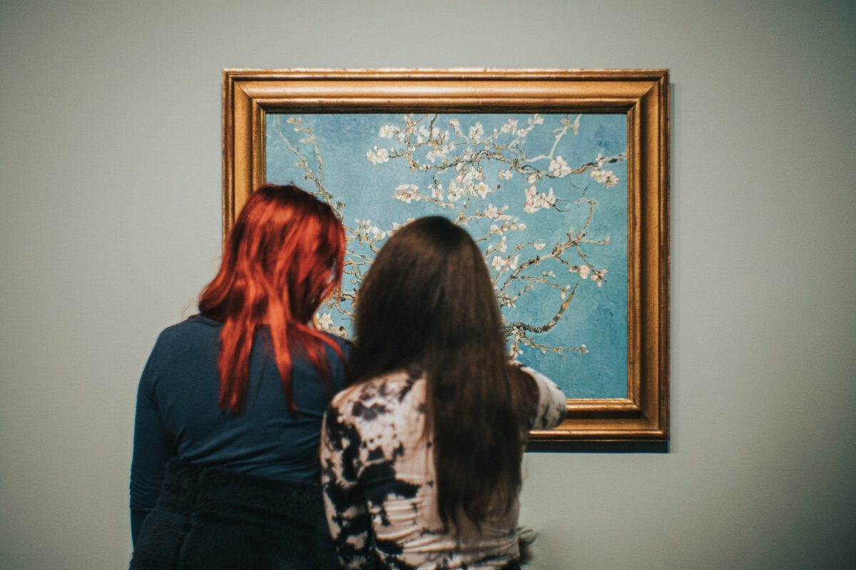 photo-of-two-women-looking-at-van-goghs-almond-blossoms