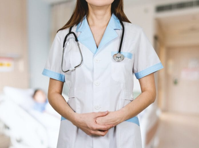 photo-of-female-nurse-standing-in-uniform-in-netherlands