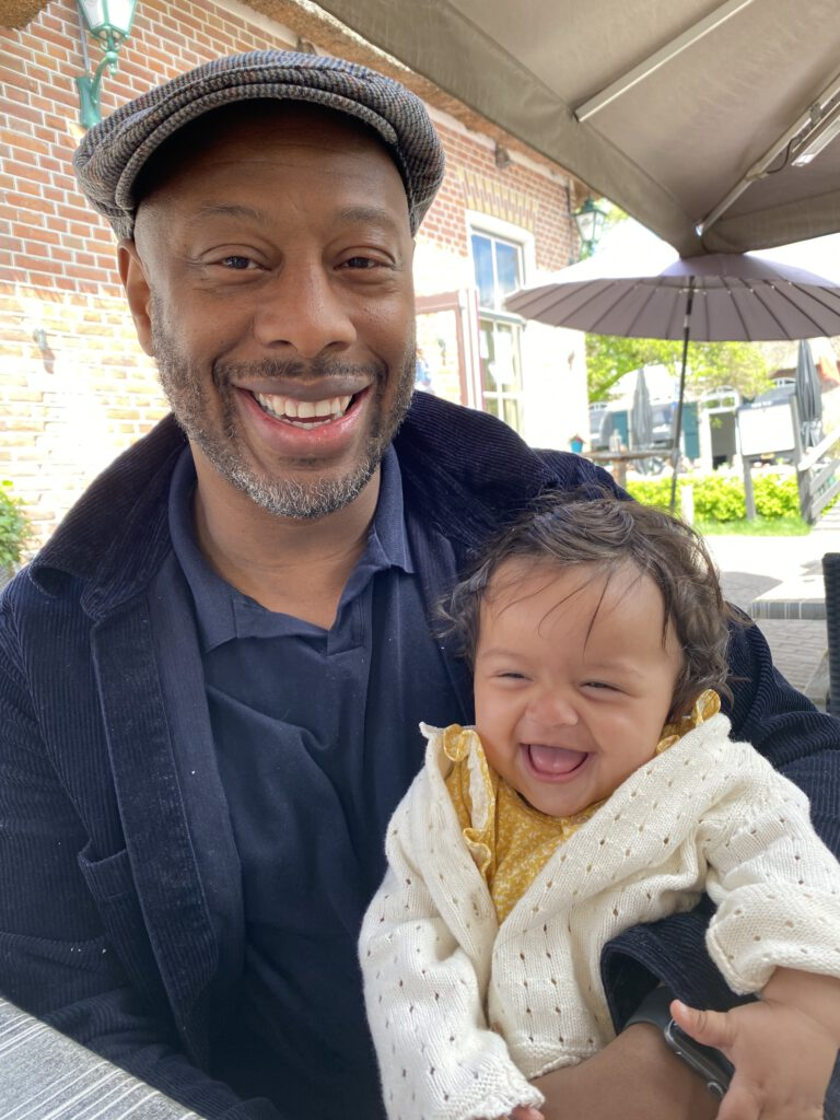 photo-of-relocation-expert-wensley-with-his-baby-daughter