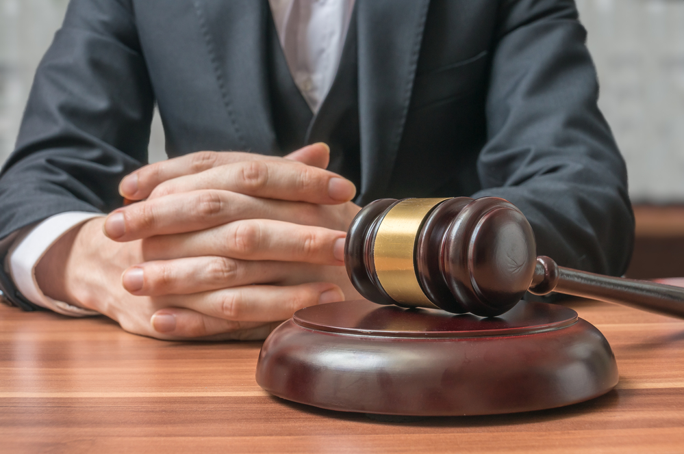 a-picture-of-a-law-gavel-in-front-of-judge