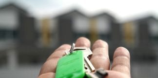 Photo-of-hand-holding-house-keys-after-buying-a-house-in-the-Netherlands