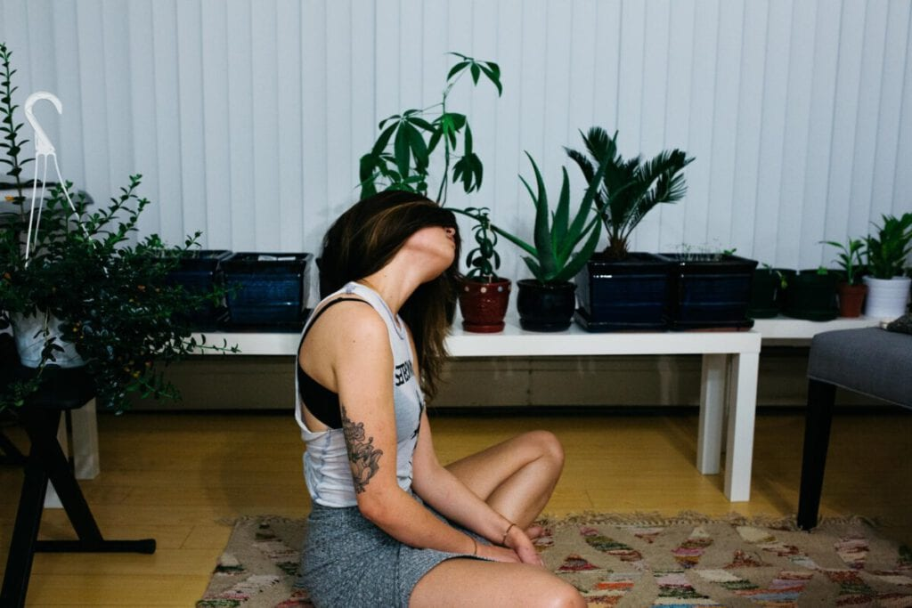 Photo-of-woman-doing-yoga-at-home