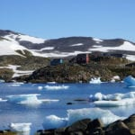 landscape-with-hills-and-lake-and-ice-and-hoouse-in-greenland