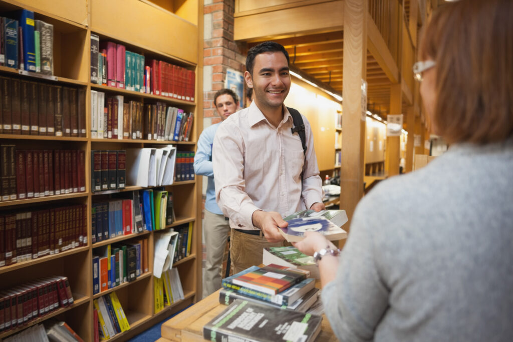 photo-young-man-checks-out-library-books-to-learn-dutch-free