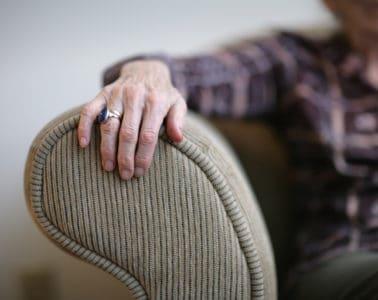 Senior woman hand on an armrest