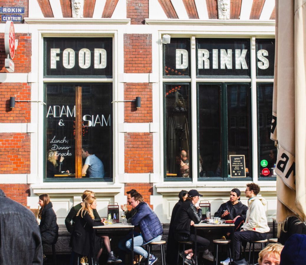 Dutch-people-sitting-outside-a-bar-on-a-terrace-in-Amsterdam
