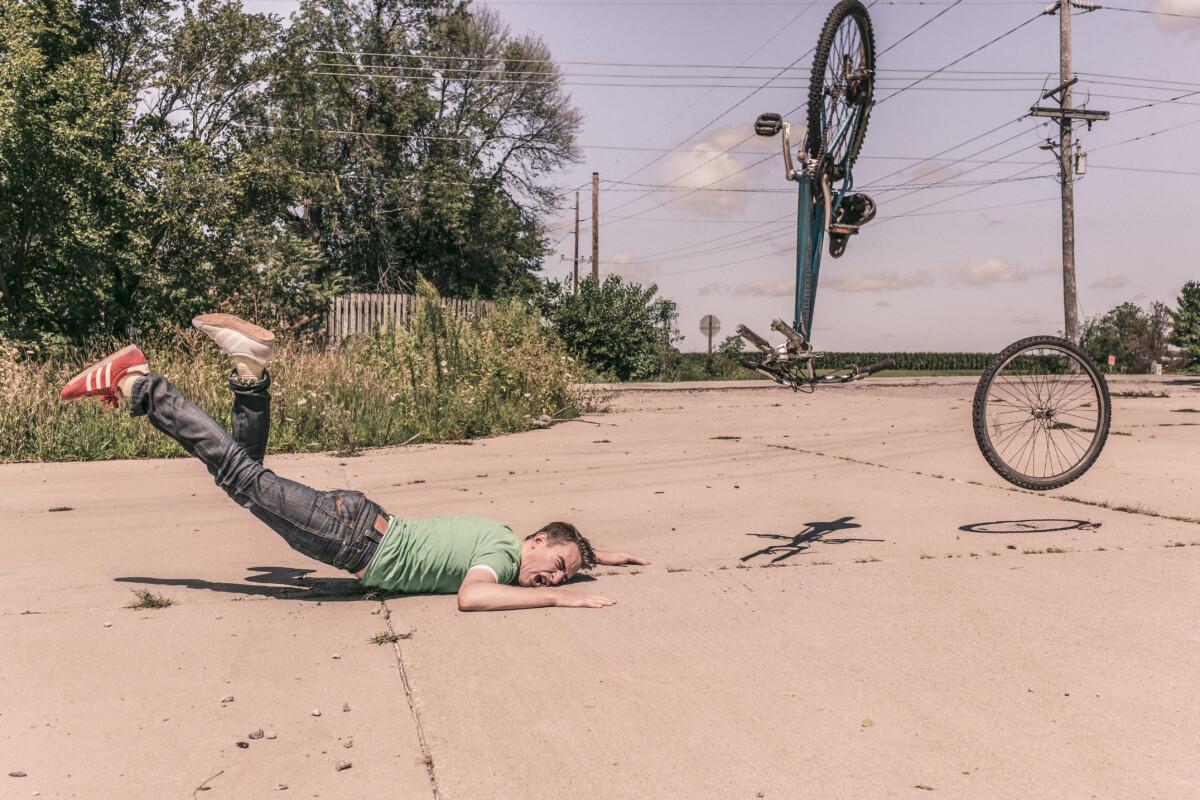 photo-of-man-fallingoff-bike