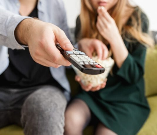 man-holding-remote-control