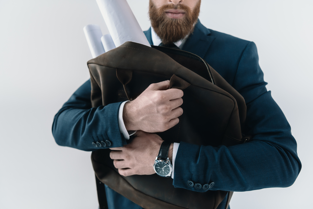 a-picture-of-a-man-hugging-bag