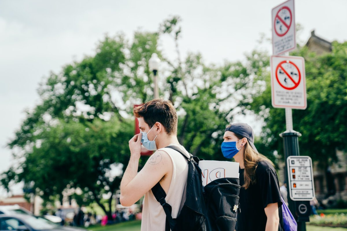 people-with-mouth-masks-at-protest
