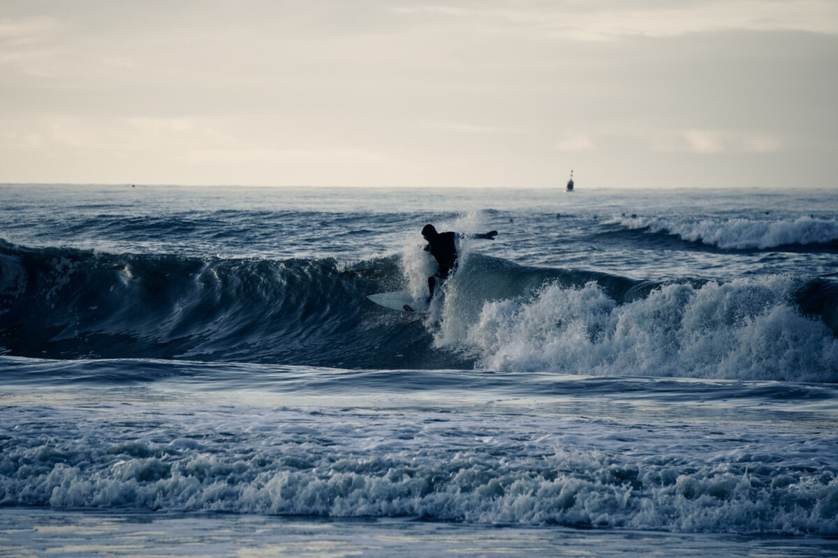 photo-of-surfing-waves-at-camperduin-beach-netherlands