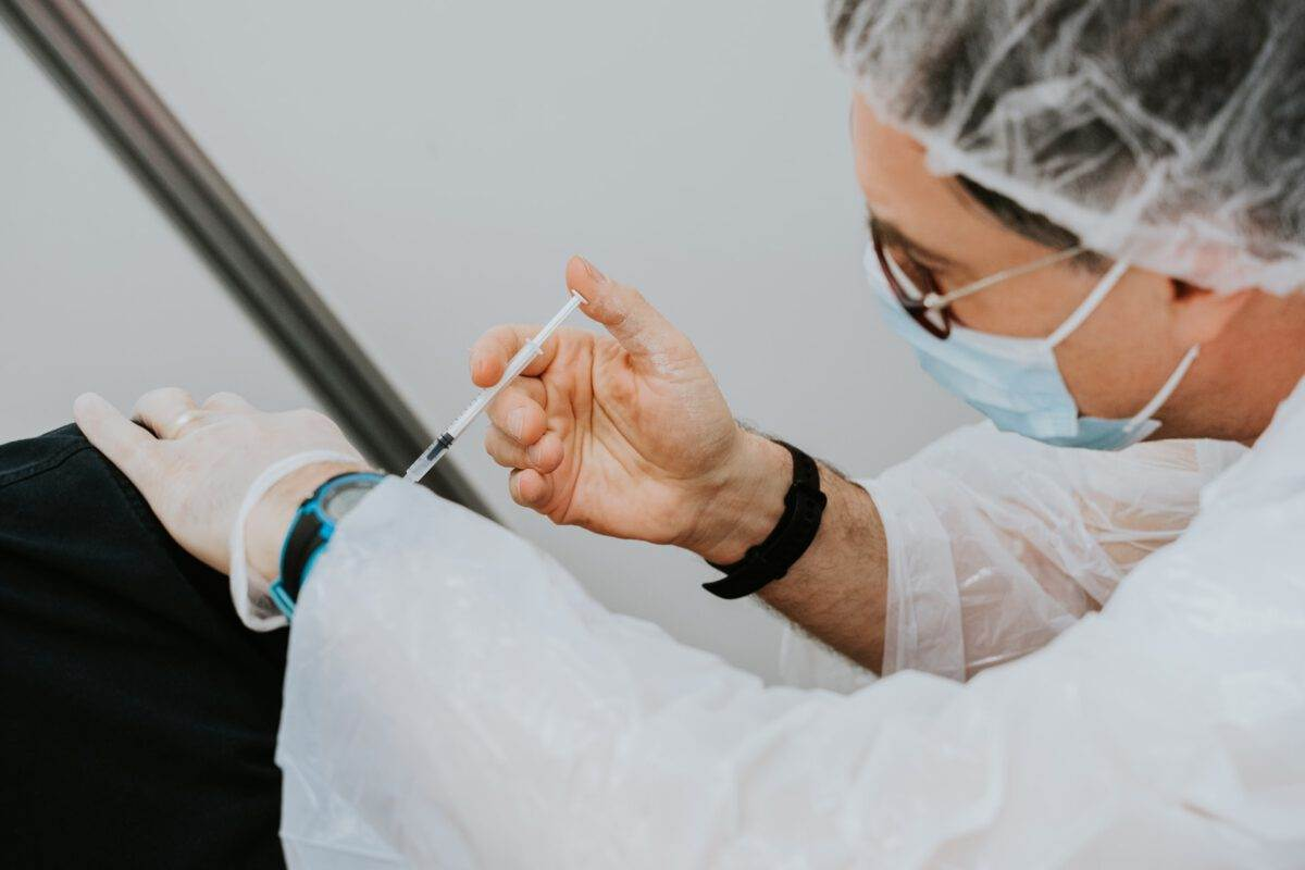 Doctor gives person a coronavirus vaccination