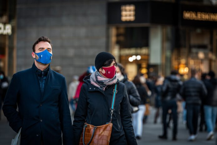 Dutch-woman-and-man-wearing-masks-standing-in-the-street