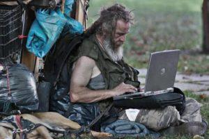 homeless man on laptop