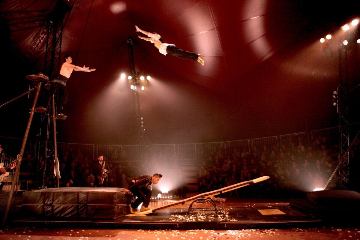 People-doing-acrobatics-in-tent