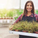 Smiling woman working in a commercial nursery