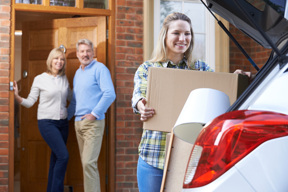 young-adult-moving-away-packing-boxes