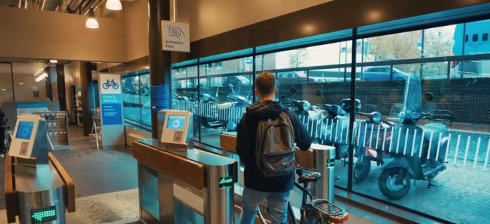 Photo-of-man-using-smart-tag-at-Dutch-train-station-bike-shed