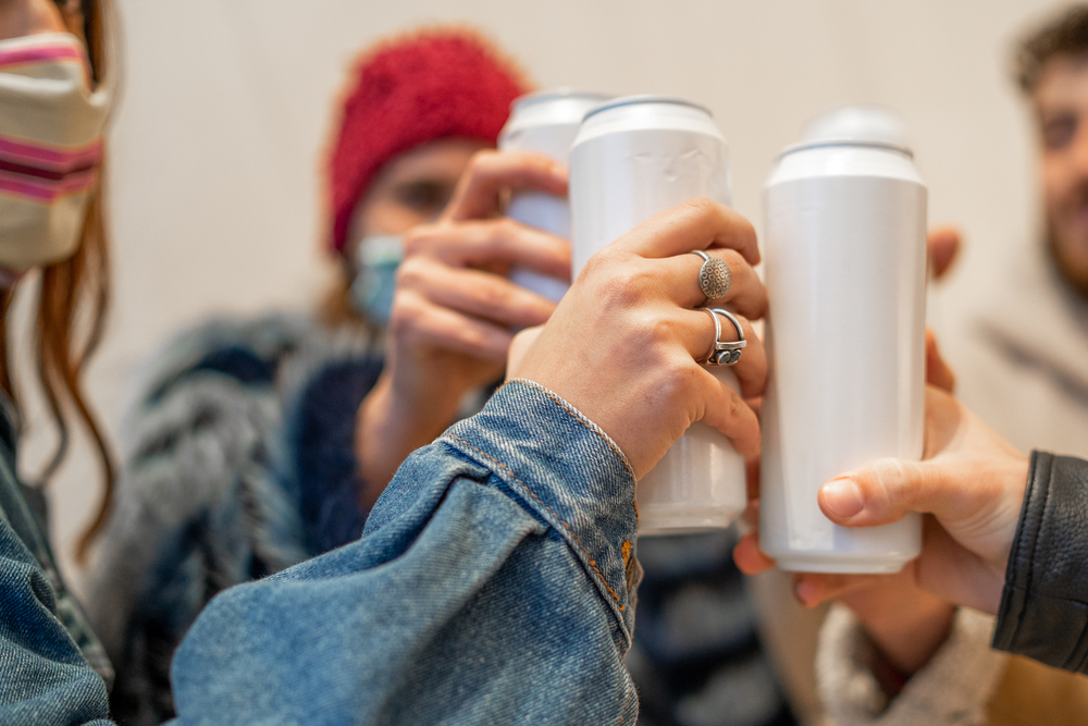 a-picture-of-a-group-of-people-partying-with-cans