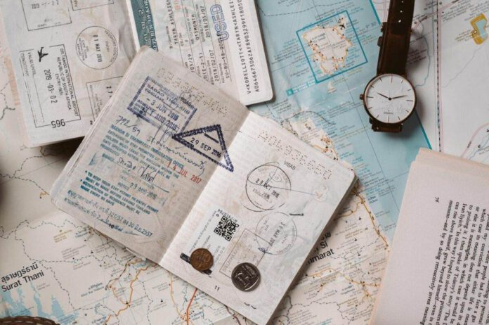 photo-of-passport-open-on-table-with-stamps