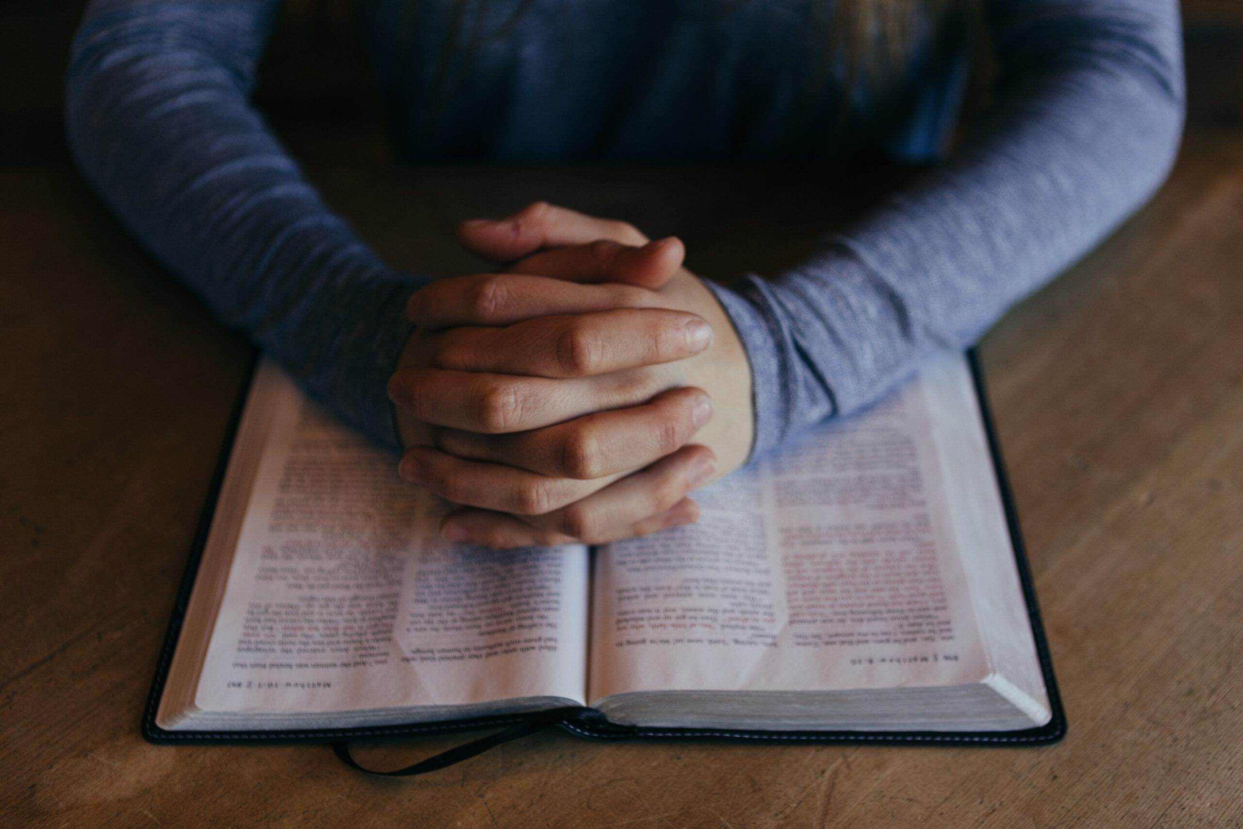 Dutch-teenager-praying-with-a-bible-in-a-gay-conversion-camp