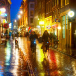 people-cycling-in-the-rain-street-amsterdam.jpeg