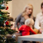 people-on-christmas-tree-at-home-during-winter-257910