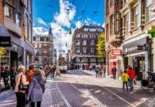people-walking-shopping-street-amsterdam-sunny-day