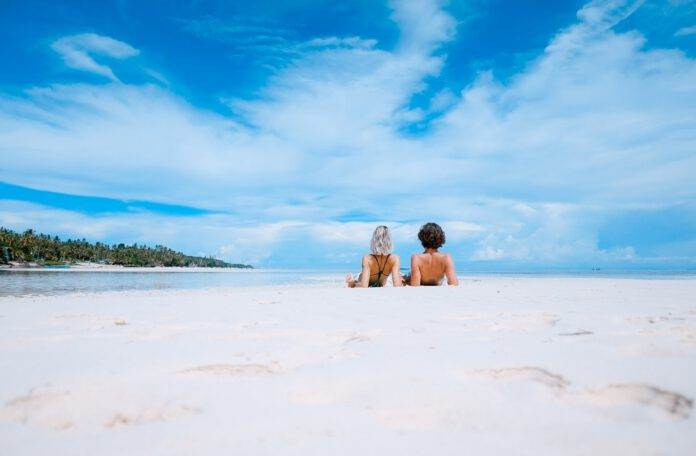 photo-of-people-sunbathing-on-beach-in-sunshine