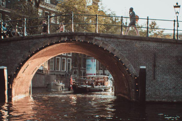person-walking-bridge-netherlands