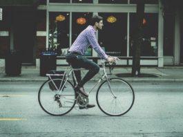 man-riding-bike-to-work-netherlands