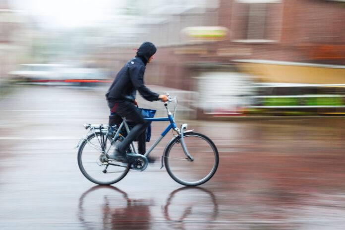 photo-of-man-cycling-biking-in-rain