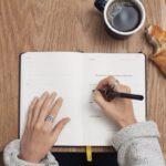 person-writing-in-dutch-agenda