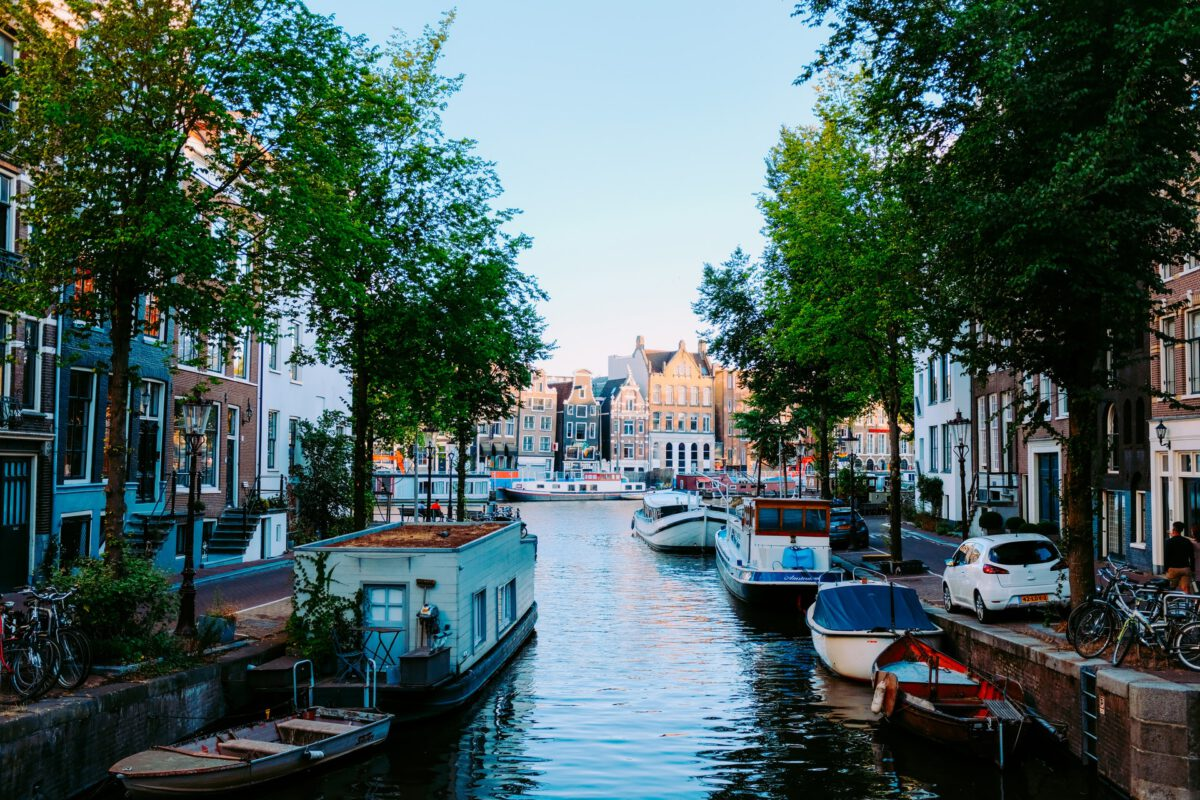 photo-of-boats-and-houseboats-on-amsterdam-canal