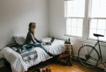 student-sitting-on-bed
