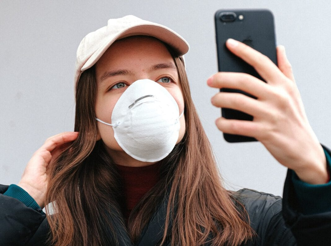 photo-of-woman-in-face-mask-taking-selfie