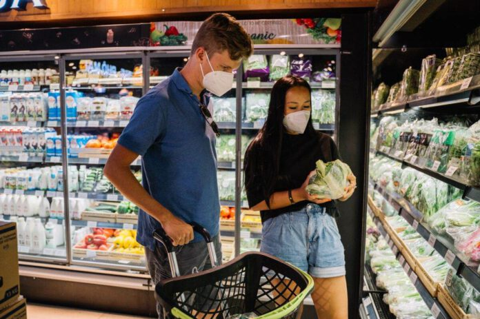 photo-of-a-couple-shopping-at-a-dutch-supermarket