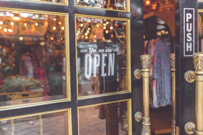 Dutch-clothes-shop-with-a-sign-saying-it-is-open