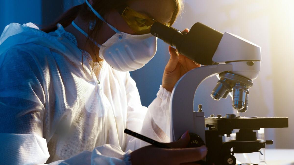 woman-microscope-covid-19-scientist