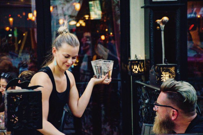 photo-of-a-waitress-serving-beer-in-a-dutch-restaurant