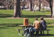 couple-sitting-on-a-bench-in-a-park-in-spring-in-the-Netherlands