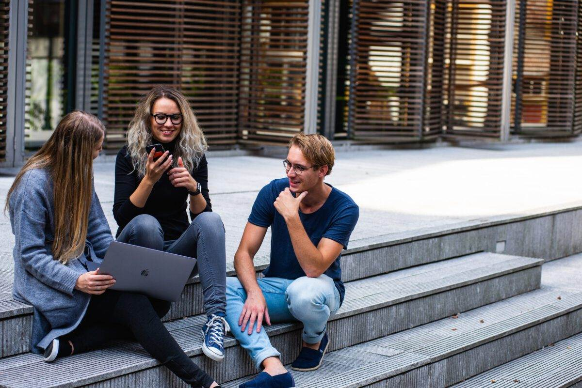 photo-of-students-sitting-in-fornt-of-a-dutch-university